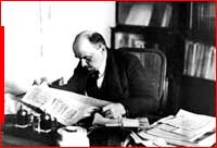 Lenin reading the paper at his desk